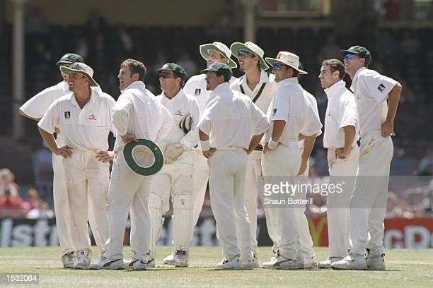 Australia watch the replay of Mark Taylor's catch to dismiss Carl Hooper during the second test match between Australia and the West Indies at Sydney...