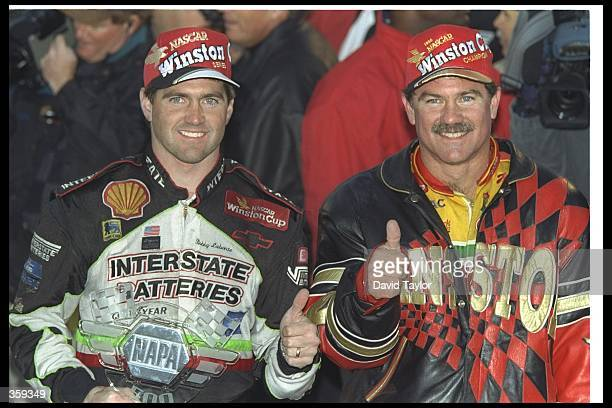 Brothers Bobby Labonte and Terry Labonte celebrate after the NASCAR NAPA 500 at the Atlanta Motor Speedway in Hampton, Georgia. Bobby Labonte won the...