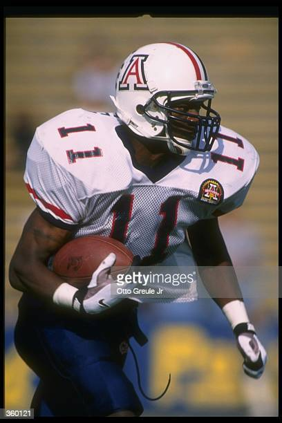 Chris McAlister of the Arizona Wildcats moves the ball during a game against the California Golden Bears at Memorial Stadium in Berkeley California...
