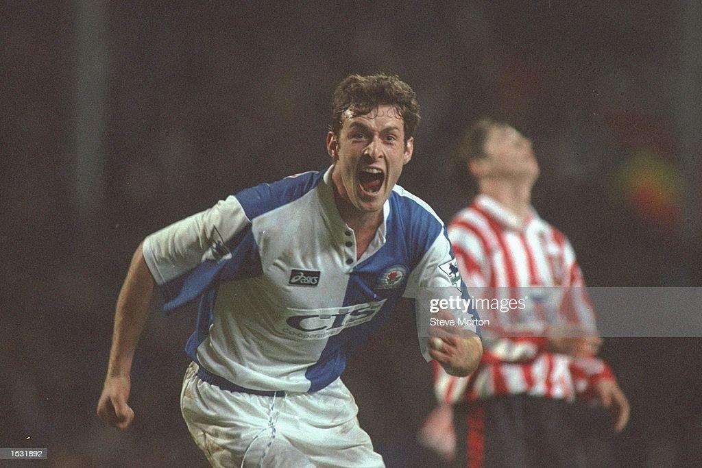 Chris Sutton of Blackburn turns to celebrate scoring : News Photo