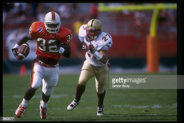 Edgerrin James of the Miami Hurricanes runs with the ball during a game against the Boston College Eagles at the Orange Bowl in Miami Florida Miami...
