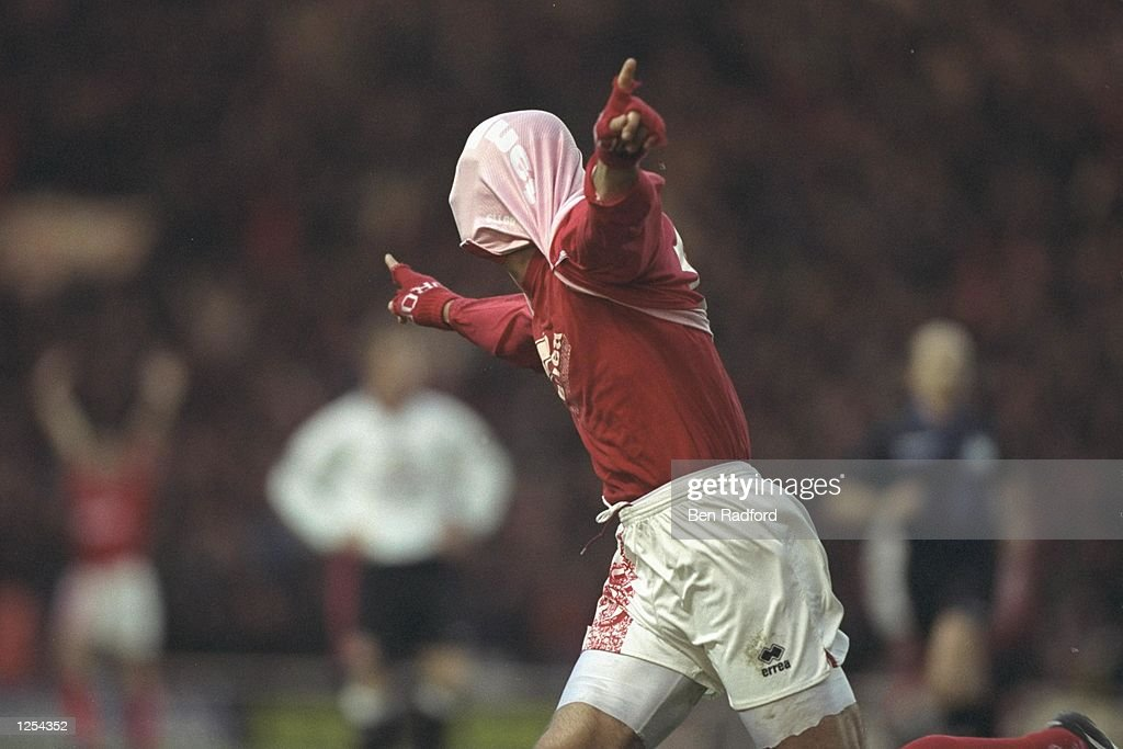 Fabrizio Ravenelli of Middlesbrough celebrates scoring in his usual style : News Photo