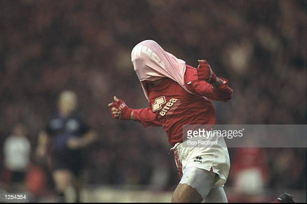 Fabrizio Ravanelli of Middlesbrough celebrates scoring in his usual style during the FA Carling Premier league match between Middlesbrough and...