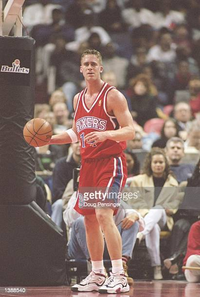 Forward Mark Hendrickson of the Philadelphia 76ers stands on the court during a game against the Washington Bullets at the US Air Arena in Landover,...