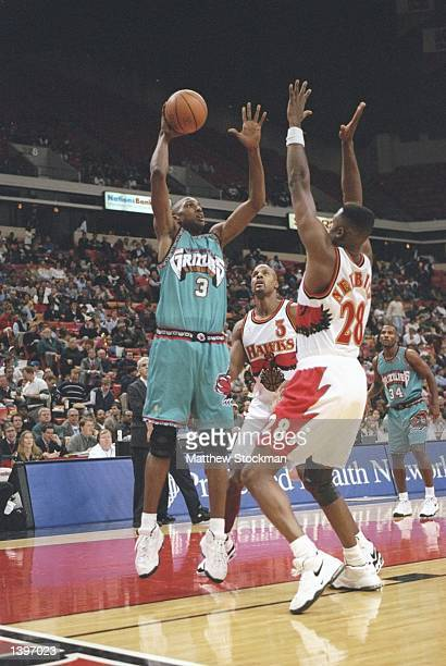 Forward Shareef AbdurRahim of the Vancouver Grizzlies in action against Ivano Newbill of the Atlanta Hawks during a game at The Omni in Atlanta...