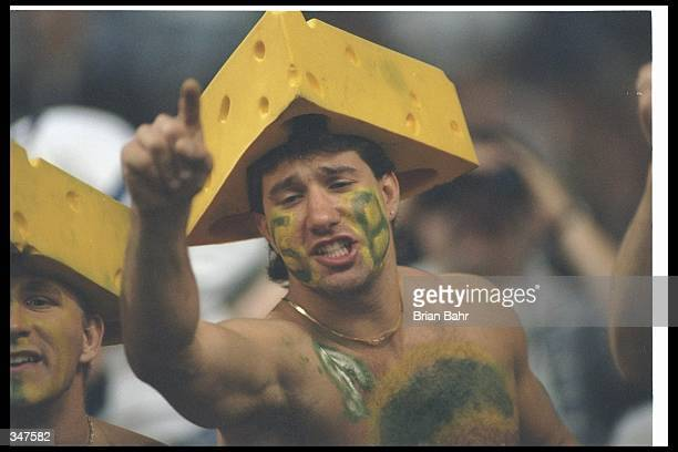 Green Bay Packers fans celebrate during a game against the Dallas Cowboys at Texas Stadium in Irving Texas The Cowboys won the game 216