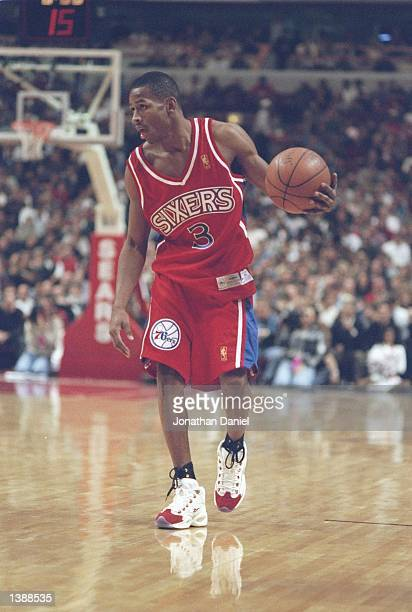 Guard Allen Iverson of the Philadelphia 76ers dribbles the ball down the court during a game against the Chicago Bulls at the United Center in...