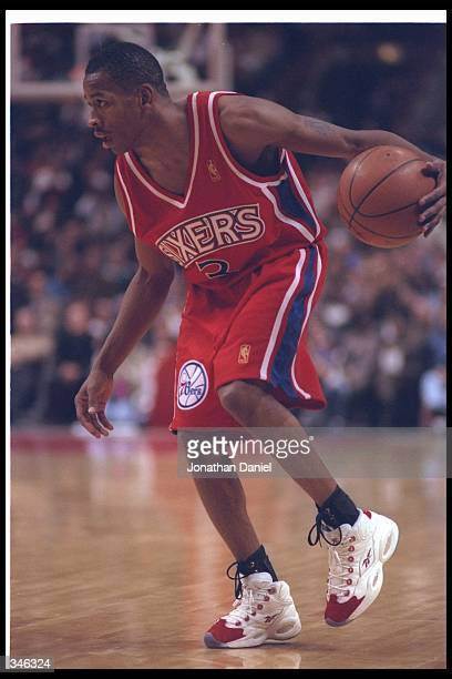 Guard Allen Iverson of the Philadelphia 76ers moves the ball during a game against the Chicago Bulls at the United Center in Chicago Illinois The...