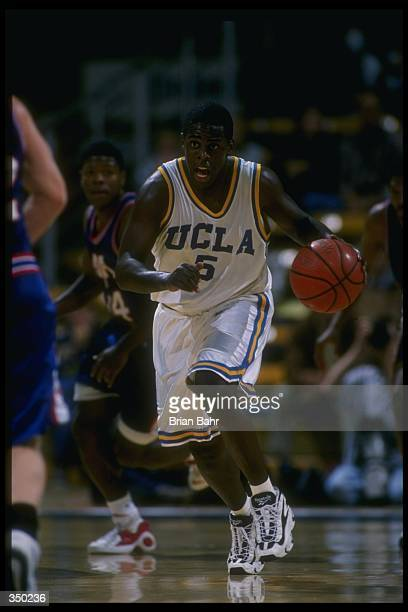 Guard Cameron Dollar of the UCLA Bruins moves down the court during a game against the Atheletes in Action at Pauley Pavilion in Los Angeles...
