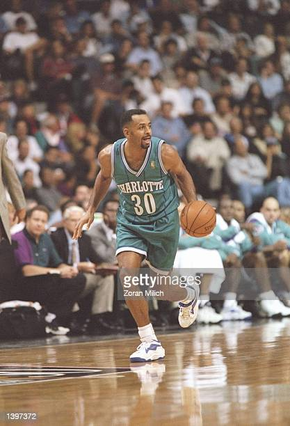 Guard Dell Curry of the Charlotte Hornets dribbles the ball down the court during a game against the Miami Heat at the Miami Arena in Miami Florida...