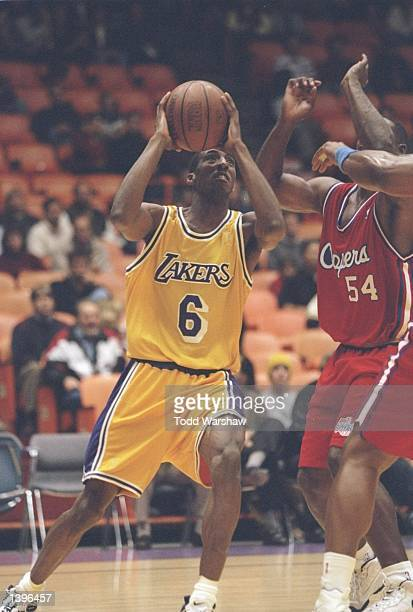 Guard Eddie Jones of the Los Angeles Lakers drives to the basket during a game against the Los Angeles Clippers at the Great Western Forum in...