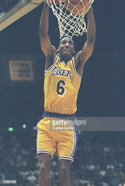 Guard Eddie Jones of the Los Angeles Lakers slam dunks the ball during a game against the Atlanta Hawks at the Great Western Forum in Inglewood...