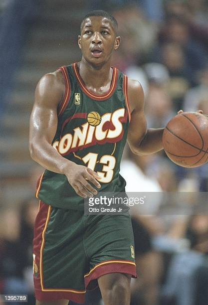 Guard Eric Snow of the Seattle Supersonics dribbles the ball down the court during a game against the Sacramento Kings at the Arco Arena in...