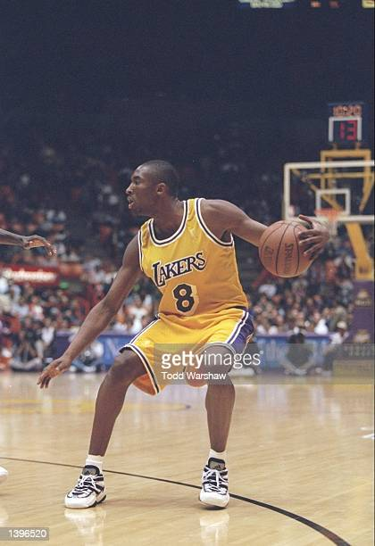 Guard Kobe Bryant of the Los Angeles Lakers dribbles the ball down the court during a game against the Los Angeles Clippers at the Great Western...