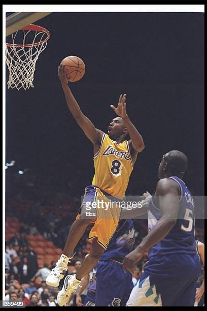 Guard Kobe Bryant of the Los Angeles Lakers goes up for two during a game against the Utah Jazz at the Great Western Forum in Inglewood California...