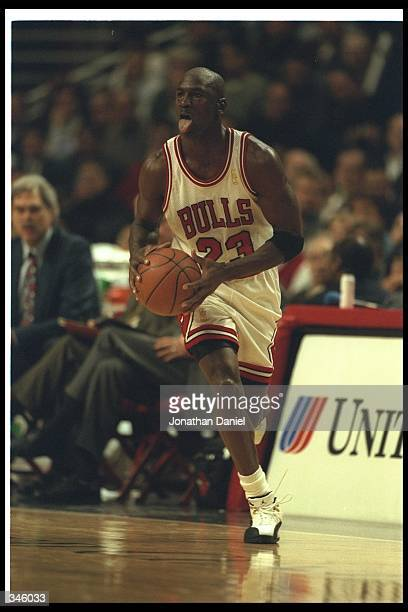 Guard Michael Jordan of the Chicago Bulls moves the ball during a game against the Phoenix Suns at the United Center in Chicago, Illinois. The Bulls...
