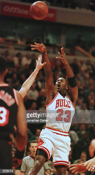 Guard Michael Jordan of the Chicago Bulls puts up a jump shot during first quarter action of the Bulls versus the Miami Heat game at the United...