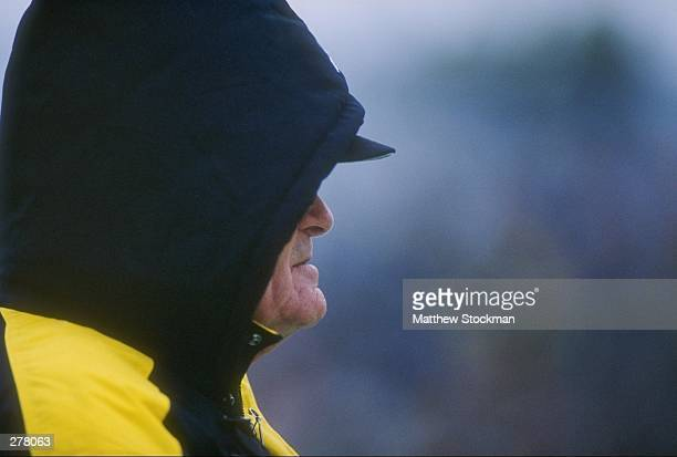 Head coach Hayden Fry of the Iowa Hawkeyes stands on the sideline with a hood over his head as he looks on during a play in the Hawkeyes 3121 victory...