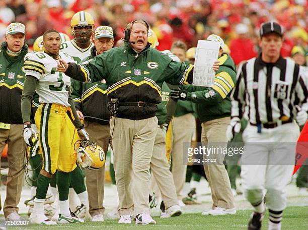 Head coach Mike Holmgren of the Green Bay Packers argues with the refs after Doug Evans was ejected during the first half of their game against the...