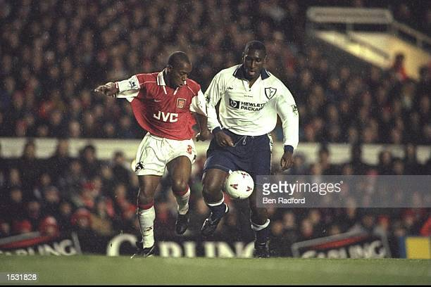 Ian Wright of Arsenal tangles with Sol Campbell of Tottenham during the FA Carling premier league match between Arsenal and Tottenham Hotspurs at...