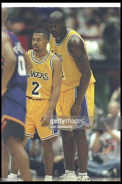 Los Angeles Lakers center Shaquille O''Neal and guard Derek Fisher look on during a game against the Phoenix Suns at the Great Western Forum in...