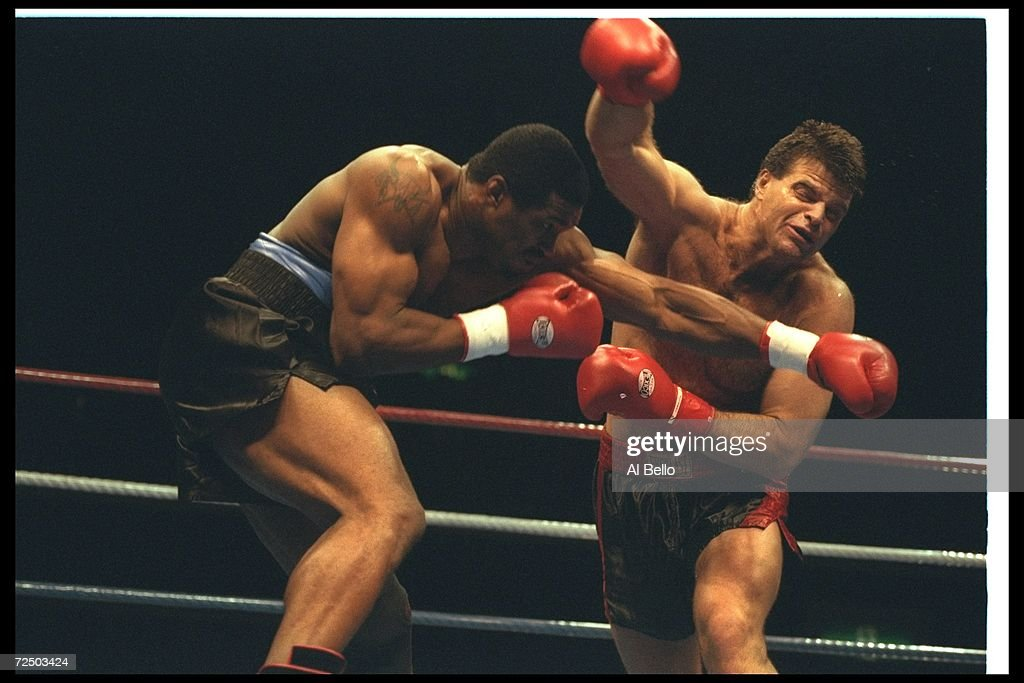 Mark Gastineau (right) and Alonzo Highsmith trade blows during a bout at Tokyo Bay NK Hall in Tokyo, Japan. Highsmith won the fight with a TKO in the second round. Mandatory Credit: Al Bello /Allsport