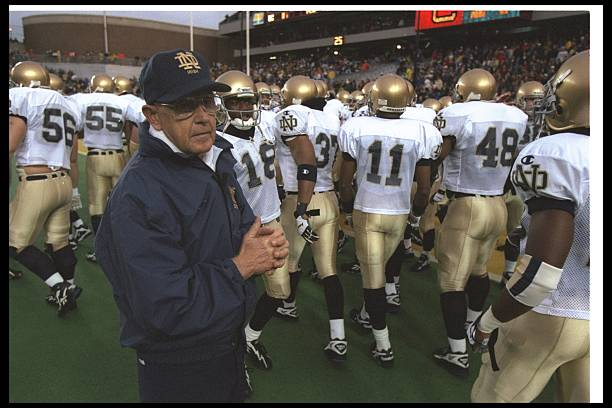 Notre Dame Fighting Irish head coach Lou Holtz looks on during a game against the Boston College Eagles at Alumni Stadium in Chestnut Hill,...