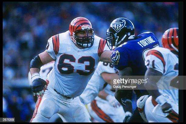 Offensive lineman Joe Walter of the Cincinnati Bengals blocks Baltimore Ravens defensive lineman Elliott Fortune during a game at Memorial Stadium in...