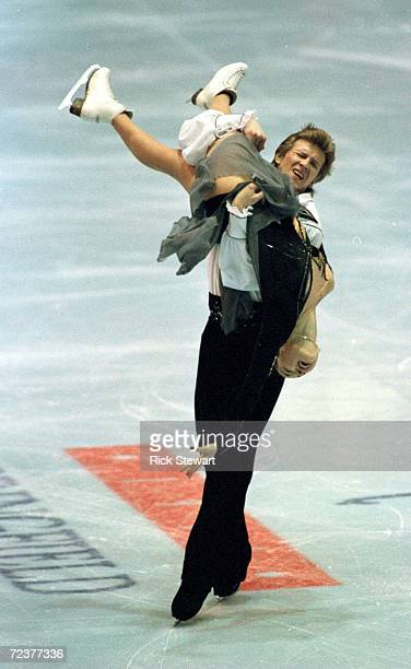 Oleg Ovsiannikov holds partner Anjelika Krylova as they skate their original dance program to wins the ice dance competition of the Thrifty Car...