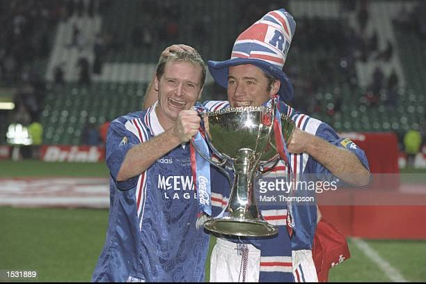Paul Gascoigne and teammate Ally McCoist pose with the trophy after the Scottish Coca Cola cup final between Rangers and Hearts at Celtic Park in...