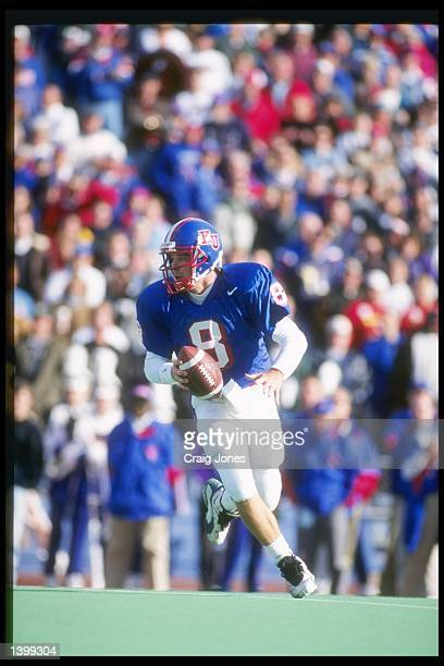 Quarterback Ben Rutz of the Kansas Jayhawks rolls out of the pocket during a game against the Kansas State Wildcats at Memorial Stadium in Lawrence...