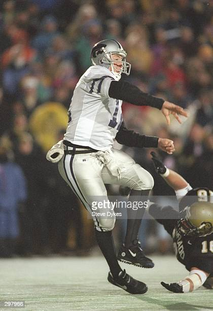 Quarterback Brian Kavanaugh of the Kansas State Wildcats passes the ball during a game against the Colorado Buffaloes at Folsom Field in Boulder...