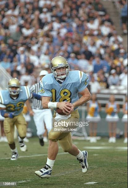 Quarterback Cade McNown of the California at Los Angeles Bruins runs down the field during a game against the Stanford Cardinal at the Rose Bowl in...