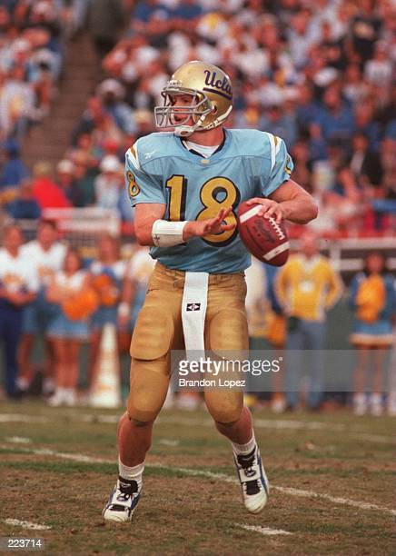 Quarterback Cade McNown of UCLA looks to throw a pass during the Bruins 2120 loss to Stanford at the Rose Bowl in Pasadena California Mandatory...