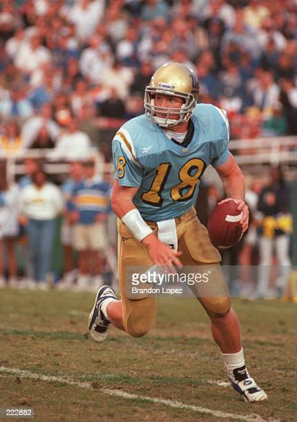 Quarterback Cade McNown of UCLA scrambles with the football during the Bruins 2120 loss to Stanford at the Rose Bowl in Pasadena California Mandatory...