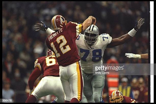 Quarterback Gus Frerotte of the Washington Redskins passes the ball as Dallas Cowboys defensive lineman Leon Lett rushes him during a game at Texas...