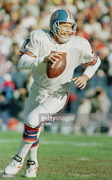 Quarterback John Elway of the Denver Broncos rolls out to pass in the first quarter of the Broncos 348 win over the New England Patriots at Foxboro...