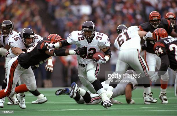 Running back Jamal Anderson of the Atlanta Falcons carries the football during the Falcons 41-31 loss to the Cincinnati Bengals at Riverfront Stadium...