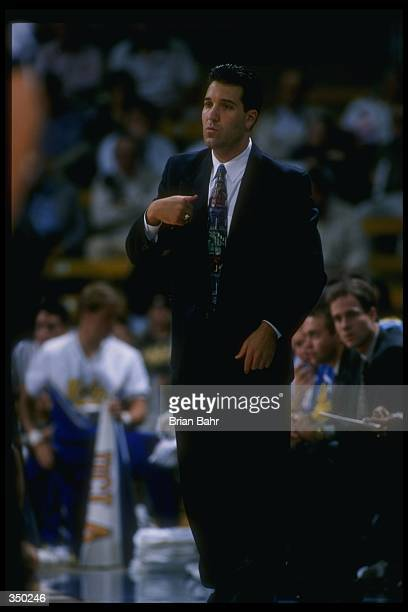 Steve Lavin looks on during a game between the UCLA Bruins and the Atheletes in Action at Pauley Pavilion in Los Angeles California UCLA won the game...