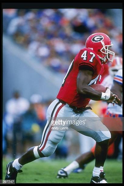 Tailback Robert Edwards of the Georgia Bulldogs runs down the field during a game against the Florida Gators at Jacksonville Stadium in Jacksonville...