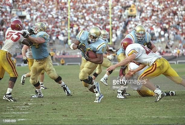 Tailback Skip Hicks of the California at Los Angeles Bruins scores the game tying touchdown during a game against the Southern California Trojans at...