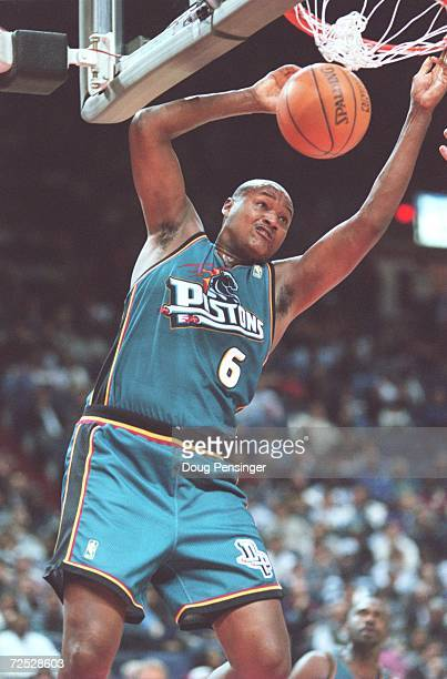 Terry Mills of the Detroit Pistons dunks the ball during their 9273 victory over the Washington Bullets at the US Air Arena in Landover Maryland...