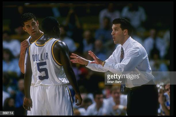 UCLA Bruins coach Steve Lavin confers with a player during a game against the Athletes in Action at Pauley Pavilion in Los Angeles California UCLA...