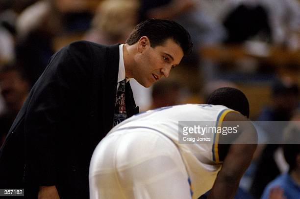 UCLA Bruins head coach Steve Lavin confers with a player during a game against Athletes in Action at Pauley Pavilion in Los Angeles California UCLA...