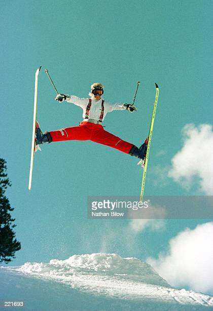 US Freestyle Mogul team member and Olympic Gold medalist Donna Weinbrecht flies through the air performing a Euro Spread at a training camp at Winter...