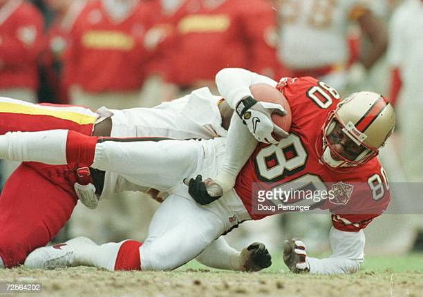 Wide Receiver Jerry Rice of the San Fransisco 49ers is pulled down by Marvcus Patton of the Washington Redskins during the first quarter at RFK...