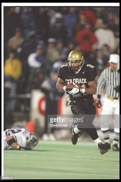 Wide receiver Rae Carruth of the Colorado Buffaloes moves the ball during a game against the Kansas State Wildcats at Folsom Field in Boulder...