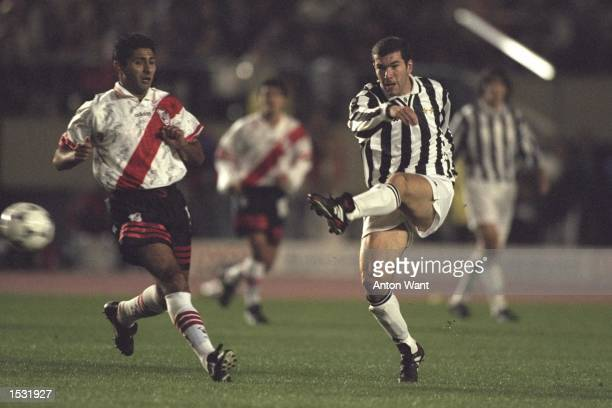 Zinedine Zidane of Juventus kicks the ball to goal during the world club final match between Juventus and River Plate for the Toyota cup at the...