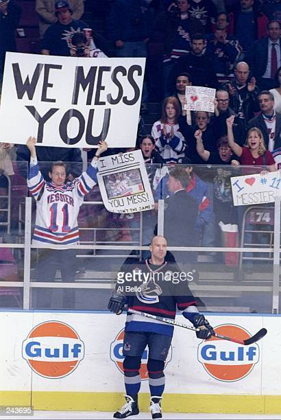 A fan of center Mark Messier of the Vancouver Canucks holds a sign during a game against the New York Rangers at Madison Square Garden in New York...
