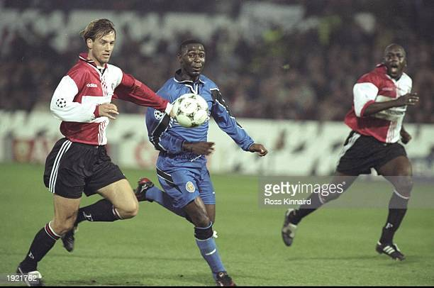 Andy Cole of Manchester United fights for the ball during the UEFA Champions League match against Feyenoord at the De Kuip Stadium in Rotterdam...